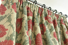 Linen pencil pleat curtain in poppies by Emily Burningham
